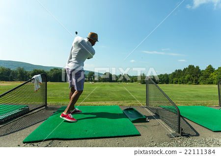 Golf Practice at the Driving Range 22111384