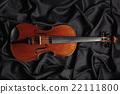 aged violin on dark texture 22111800