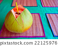 Green coconut with drinking straw 22125976