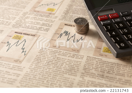 Newspaper stock market with calculator and money 22131743