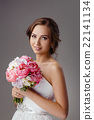 Bride with wedding bouquet studio shooting 22141134