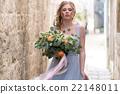 Young bride portrait with a wedding bouquet 22148011