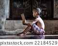Asian boy reading book 22184529