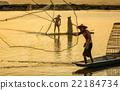 Fisherman in action when fishing in the lake 22184734