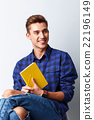 Handsome male student is preparing for studying 22196149