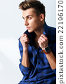 Attractive young guy is evincing his seriousness 22196170