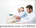 Cheerful three colleagues are working in 22196662