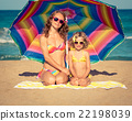Mother and child having fun on the beach 22198039
