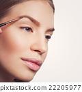 Woman correcting eyebrows form 22205977