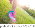 View of jogger legs running on the grass 22212210