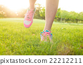 View of jogger legs running on the grass 22212211