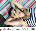 Young smiling woman in sailor outfit is lying on the retro blank 22218184