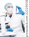 Cheerful male researcher is working in laboratory 22229558