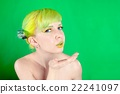 Young attractive woman with green hair sends an air-kiss 22241097