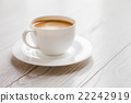 hot coffee in white cup on vintage wooden table 22242919