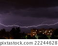 Thunderstorm with lightning in the night sky over  22244628