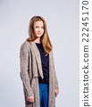 Girl in jeans and long sweater, woman, studio shot 22245170