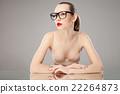 Portrait of young woman in glasses and bra looking 22264873