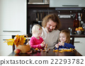 Father and his kids making chestnuts creatures 22293782
