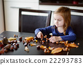 Little girl making chestnuts creatures 22293783