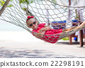 Adorable little girl on tropical vacation relaxing 22298191