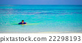 Happy young surf man at white beach with yellow 22298193