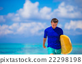 Happy young surf man at white beach with yellow 22298198