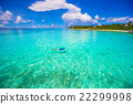 Young man snorkeling in clear tropical turquoise 22299998