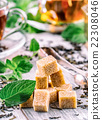 Sugar. Cane sugar. Cane sugar cubes heap close 22308046