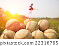 Baseball players practice wave a bat in a field 22316795