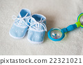 baby shoes and rattle on light background 22321021