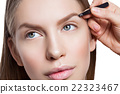 Woman correcting eyebrows form 22323467