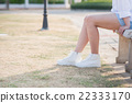 woman in white sneakers  walking under sunlight 22333170
