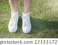 woman in white sneakers  walking under sunlight 22333172