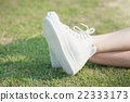 woman in white sneakers  walking under sunlight 22333173