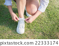 woman in white sneakers  walking under sunlight 22333174