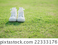 white sneakers on green grass 22333176