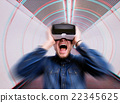 Man wearing virtual reality goggles., standing in 22345625