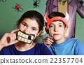 boy and girl halloween party preparation 22357704