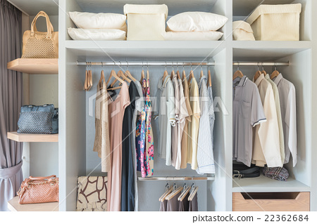 white wardobe and dressing table with clothes  22362684