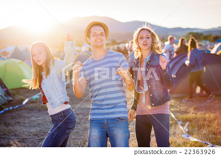 Group of teenagers at summer music festival, sunny 22363926