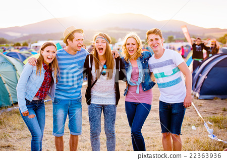 Group of teenagers at summer music festival, sunny 22363936