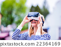 Woman wearing virtual reality goggles in the 22364169