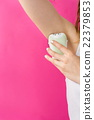 Woman epilates her armpit with an epilator 22379853