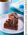 Chocolate cake with tea, plate on blue background 22389842