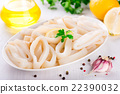 Raw squid rings on white plate, ready to cook 22390032