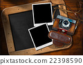 Old Camera with Empty Photos and Blackboard 22398590
