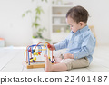 A boy playing with a toy 22401487