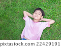 Little boy lay down on the grass 22429191