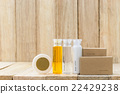 Tubes of bathroom amenity contains on wood 22429238